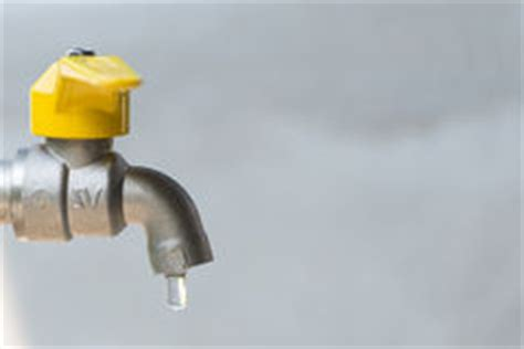 Yellow Water From Faucet by Leaking Outdoor Spigot Royalty Free Stock Photo Image