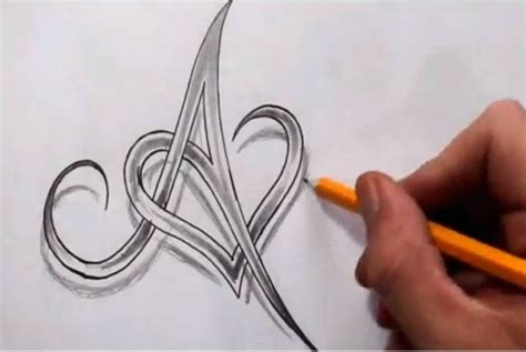 tattoo of alphabet a with heart initial a and heart combined together celtic weave style