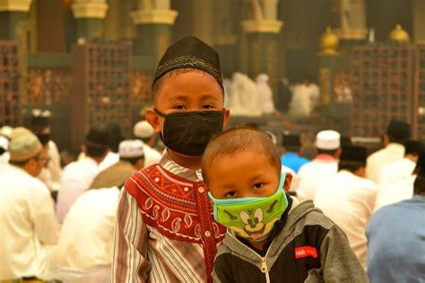 Masker Asap pameran foto dan karikatur kabut asap kami rindu langit