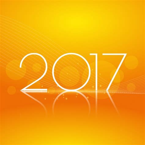 yellow bokeh new year 2017 background vector free download
