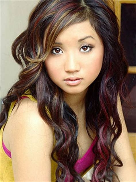 brenda song s curly layered hairstyle with multi colored