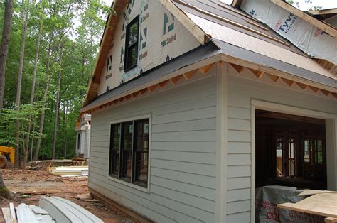 rafter tails go up pool goes in modern craftsman style