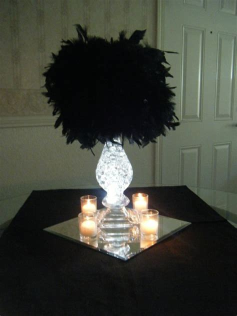 black feather centerpieces 301 moved permanently