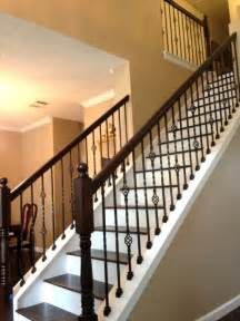Christmas Banister Ideas Wood Stairs With Wrought Iron Balusters Stairway Remodel