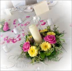 candle arrangements for table pink and yellow themed wedding on lake orta italy