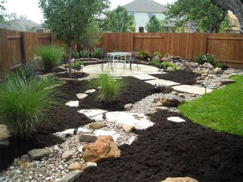 Creek Rock Patio by Water Feature Disappearing Into A Creek Bed With A