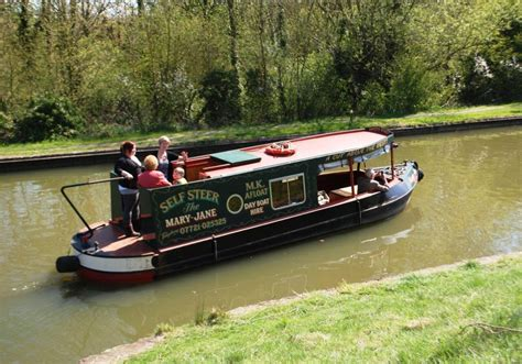 party boat hire milton keynes barges on the union canal at woughton medieval village