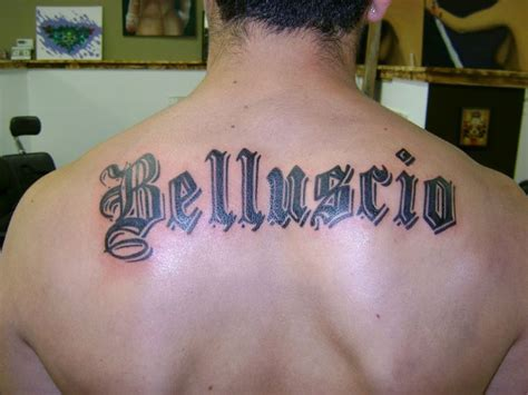 last name on back tattoo designs last name across back ideas