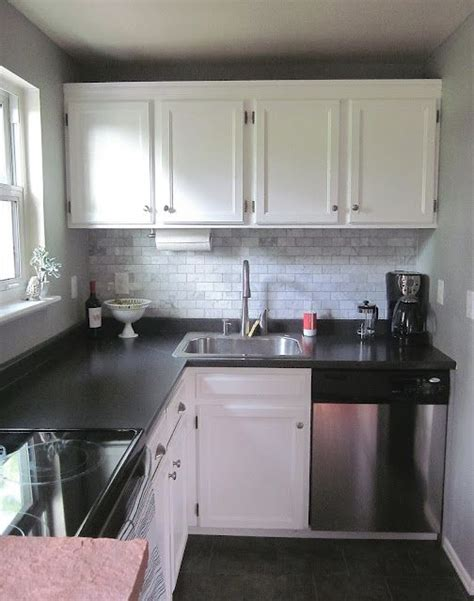 Lovely Small Kitchen With Black Laminate Countertops And Small Kitchen With Black Cabinets