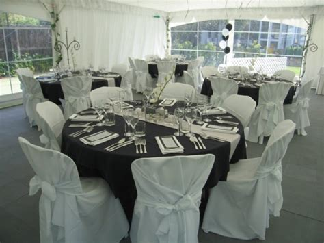 Formal dinner setting done in black, silver & white theme