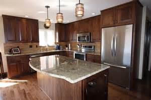 Walnut Kitchen Cabinets Granite Countertops | earth tone kitchen remodeled with walnut cabinetry