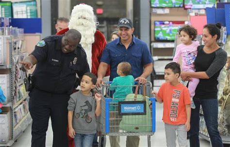 Free Gift Cards For Low Income Families - 50 underprivileged kids get to shop with a cop for presents miami herald miami herald