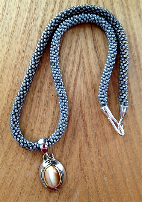 the simple cat s eye beaded kumihimo braiding project