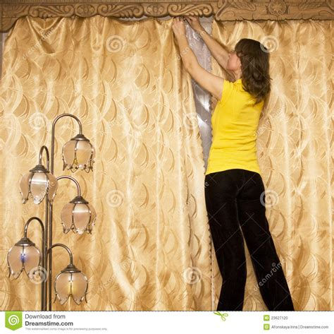 curtains woman woman hanging curtains stock photo image 23627120