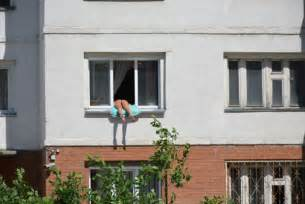 russian sunbathing by hanging out apartment