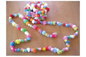 How To Make Paper Pom Pom Garland - make a pom pom garland kiddley