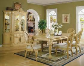 antique white formal dining room with carving details