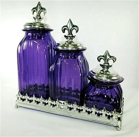 purple kitchen canister sets fleur de lis kitchen canisters set of 3 purple glass