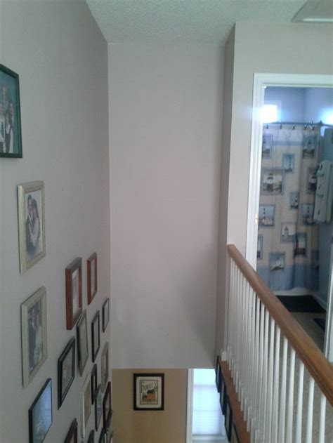 how to decorate wall tall narrow wall above stairs