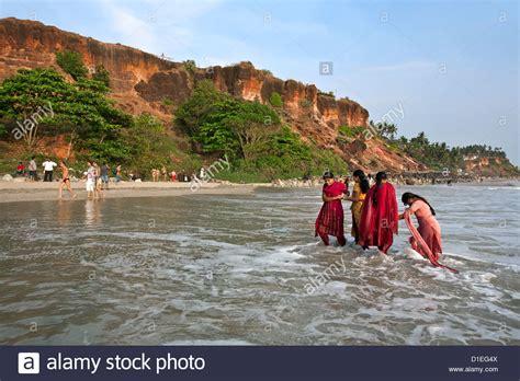 indian bathing in the sea varkala