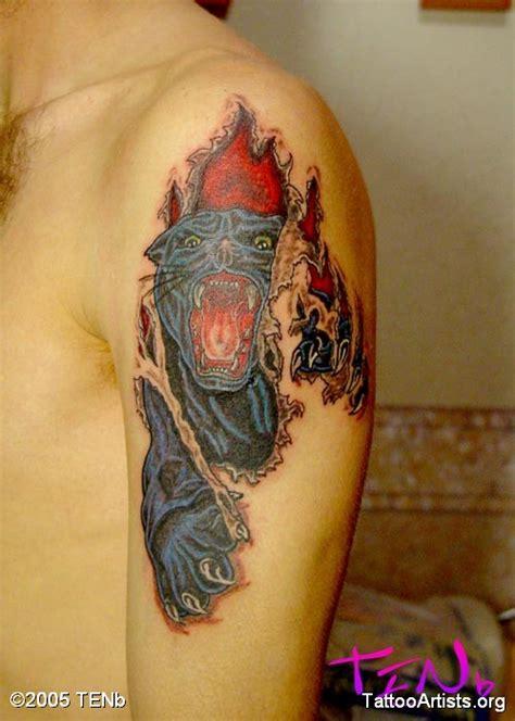 tattoo animal skin panther ripping skin pictures to pin on pinterest tattooskid