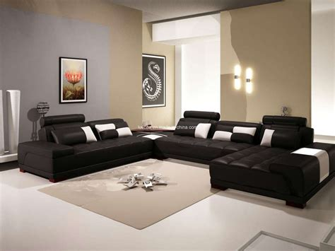 Living Room With Black Furniture Brown Leather Sectional Sofa Chesterfield Using Black Iron Based Legs As Well As Modern