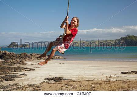 rope swing new zealand oakura bay northland north island new zealand stock