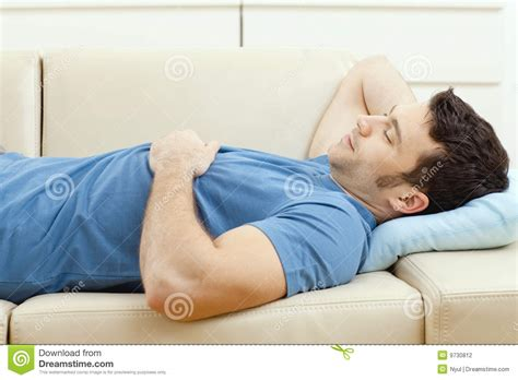 sleeping on a couch man sleeping on couch stock photography image 9730812