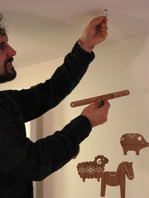 How To Hang Baby Mobile From Ceiling by How To Hang A Baby S Mobile From A Ceiling How Tos Diy
