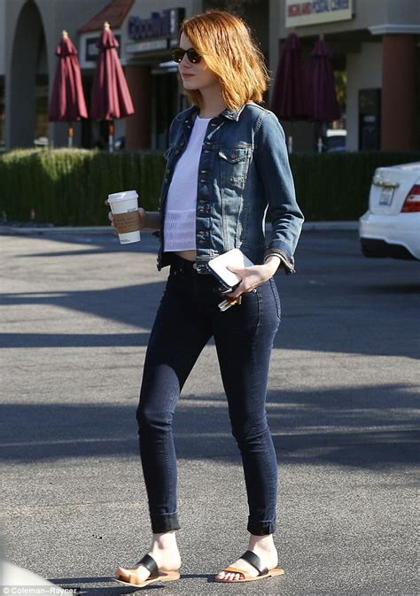 emma stone daily mail emma stone allows a glimpse of her tummy while on coffee
