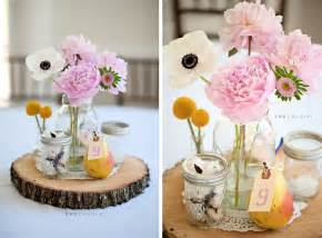 702 in a beautiful collection of wedding centepieces with mason jars