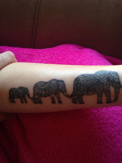 elephant tattoo trunk to tail wonderful great ornamented elephant family hanging by