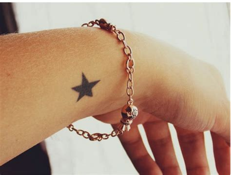 shooting star tattoo on wrist 35 awesome designs