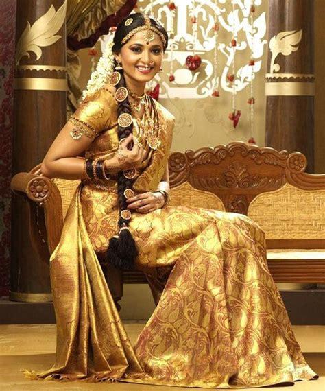 bridal hairstyles for silk saree anushka in gold silk saree bridal saree saree