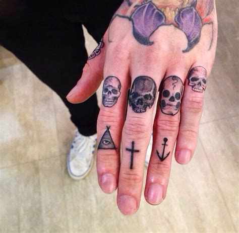 skulls on fingers best tattoo design ideas