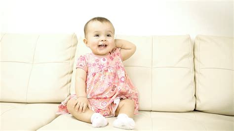 baby on couch smiling baby sitting on the sofa stock footage video