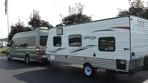 with trailer towing a travel trailer with a roadtrek roadtreking
