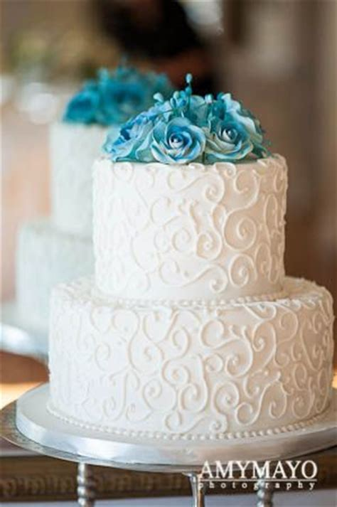 2 tier wedding cake with blue flowers   Wedding cakes