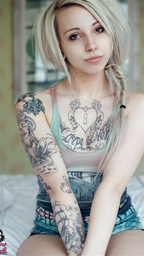 tattoo on chest of girl suicide girls have cool tattoos tattoos piercings