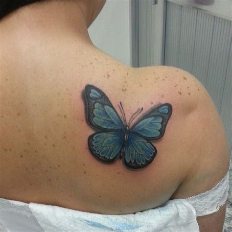 Blue Colored Butterfly Tattoo On Back Shoulder For Women Blue On Shoulder