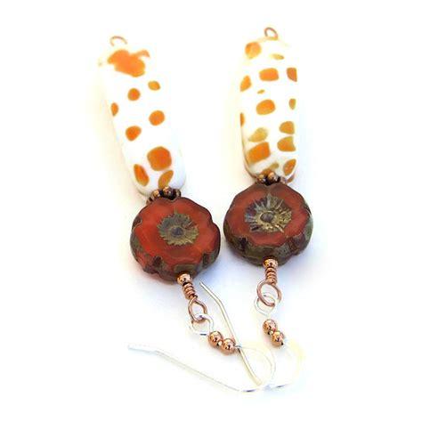 Handmade Shell Earrings - orange and white mitra shell earrings pansy flower
