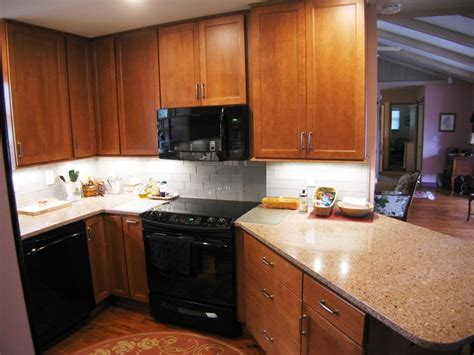 Quartz Composite Countertops Vs Granite by Countertops Granite Vs Quartz Duncan S Creative Kitchens