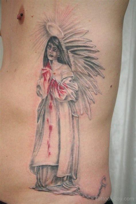 tattoo angel on ribs guardian angel tattoos tattoo designs tattoo pictures