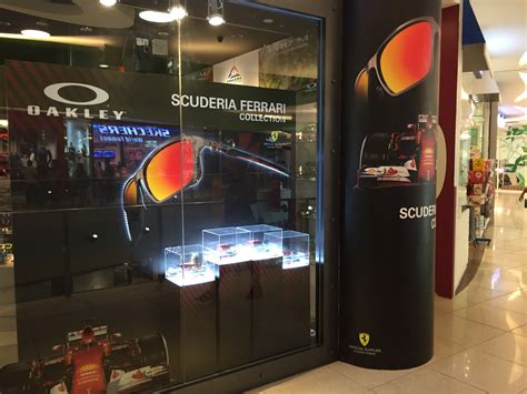 Kaos Racing F1 Singapore 2015 Merchandise oakley and scuderia window display colordoc