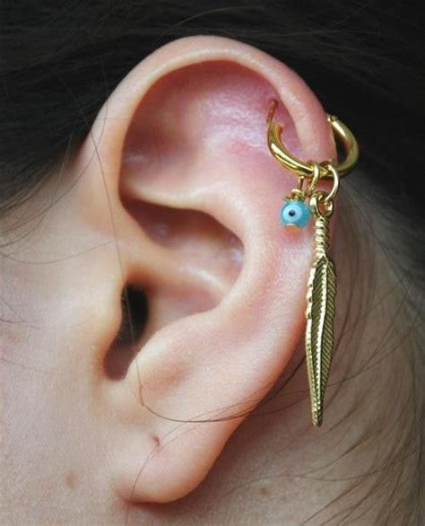 gold feather cartilage piercing earrings cartilage