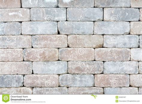 background texture of a tumbled brick wall stock photo