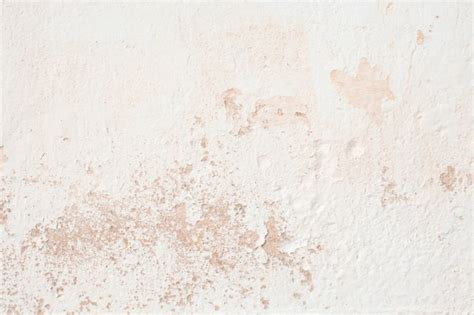 kaffeeflecken wand white cement wall with pink spots photo free