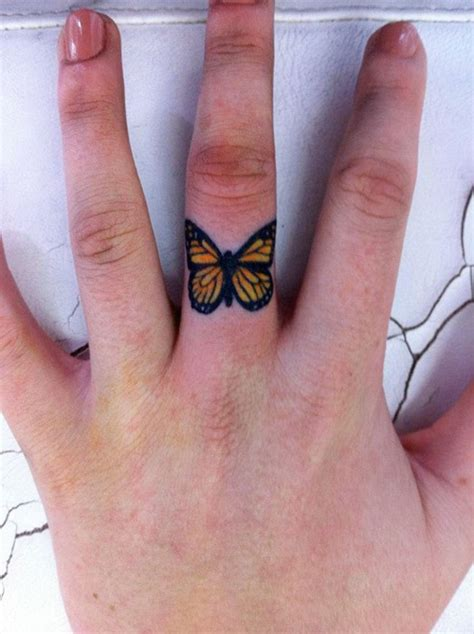 butterfly tattoo designs on hand butterfly finger designs ideas and meaning