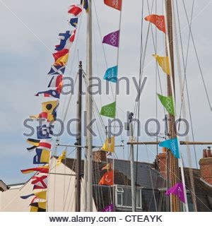 london 2012 olympic games bunting along the river thames yachts in weymouth harbour dorset england uk stock