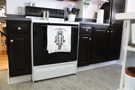 black stained kitchen cabinets how to refinish oak cabinets with stain the big reveal